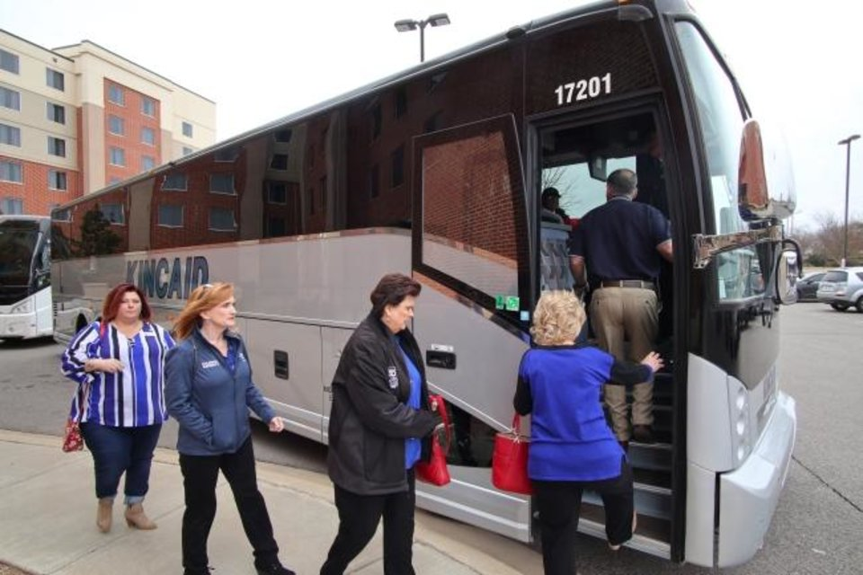 Photo -  Realtors board a bus Wednesday to take them to the Capitol from the Oklahoma Association of Realtors Capitol Conference at the downtown Embassy Suites. [DOUG HOKE/THE OKLAHOMAN]