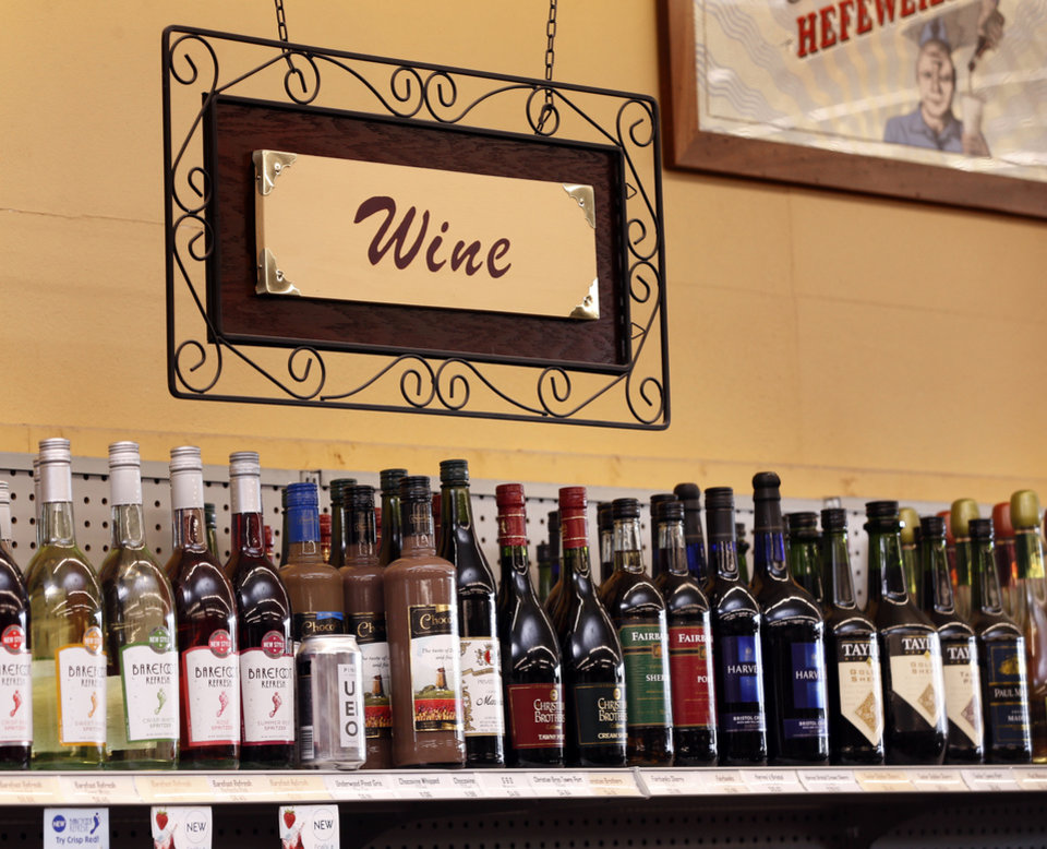 Photo -  Wine and spirits are seen Wednesday at Moore Liquor in Moore. A bill under consideration at the Oklahoma Legislature would allow counties to vote on Sunday liquor sales. [Photo by Steve Sisney, The Oklahoman]