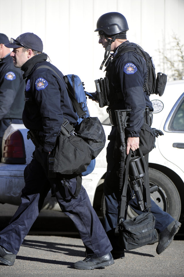 Police respond to the scene of a barricaded man, Saturday, Jan. 5, 2013 in Aurora, Colo. Four people, including an armed suspect, died during an hours-long police standoff Saturday at a Colorado townhome, authorities said. (AP Photo/The Denver Post, Andy Cross) MAGS OUT; TV OUT; INTERNET OUT