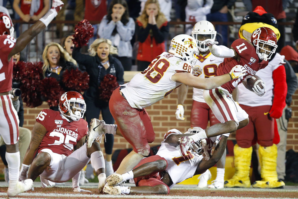Photo - Oklahoma's Parnell Motley (11) intercepts a pass in front of Iowa State's Charlie Kolar (88) and La'Michael Pettway (7) during an NCAA football game between the University of Oklahoma Sooners (OU) and the Iowa State University Cyclones at Gaylord Family-Oklahoma Memorial Stadium in Norman, Okla., Saturday, Nov. 9, 2019. [Bryan Terry/The Oklahoman]