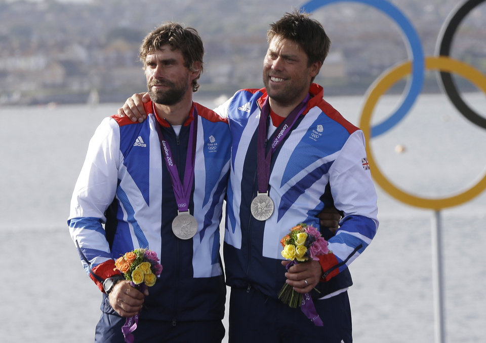 Photo - In this Aug. 5, 2012, file photo, Great Britain's star class crew Iain Percy, left, and Andrew Simpson celebrate their silver medal at the London Summer Olympics in Weymouth and Portland, England. Artemis Racing says Simpson died Thursday, May 9, 2013, after the team's boat capsized during training for the upcoming America's Cup in San Francisco Bay. (AP Photo/Bernat Armangue, File)