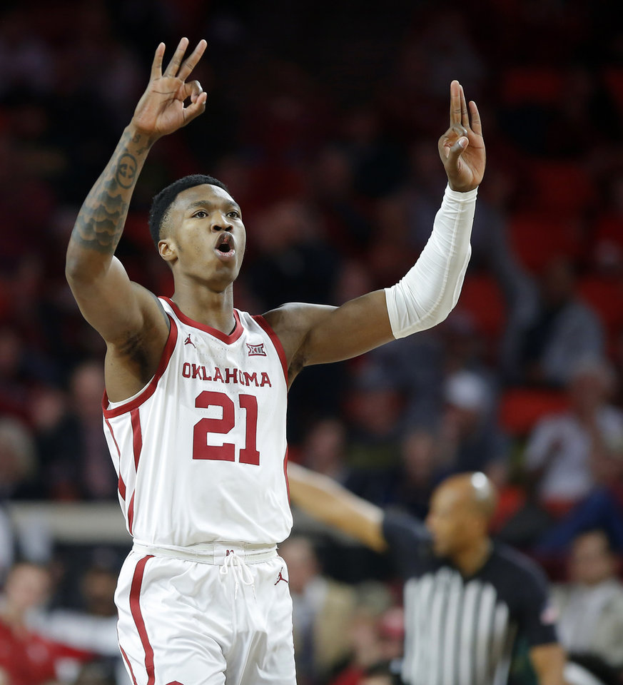 Photo - Oklahoma's Kristian Doolittle (21) celebrates after making a 3-pointer during a men's NCAA basketball game between the University of Oklahoma Sooners (OU) and the Baylor Bears at the Lloyd Noble Center in Norman, Okla., Tuesday, Feb. 18, 2020. [Bryan Terry/The Oklahoman]