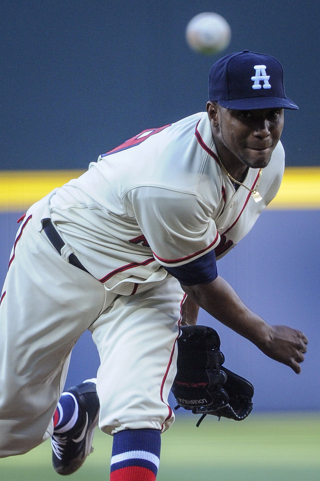 Photo - Atlanta Braves pitcher Julio Teheran works the mound against the San Francisco Giants during the first inning of a baseball game, Saturday, May 3, 2014, in Atlanta. (AP Photo/John Amis)