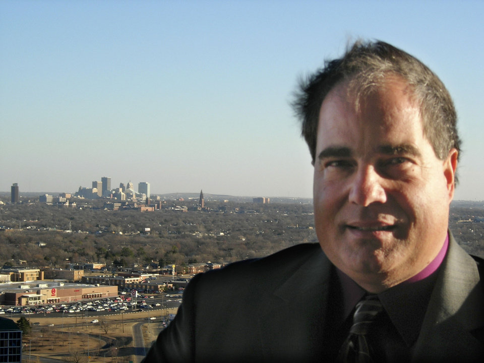 Photo - RENOVATE, RENOVATED, RENOVATION: The former United Founders Tower is being converted from office space to living space by the Bridgeport Development Group. Mark Livingston, president, with the view towards downtown from the 19th floor Tuesday, Dec. 5, 2006. By Steve Lackmeyer, The Oklahoman. ORG XMIT: KOD
