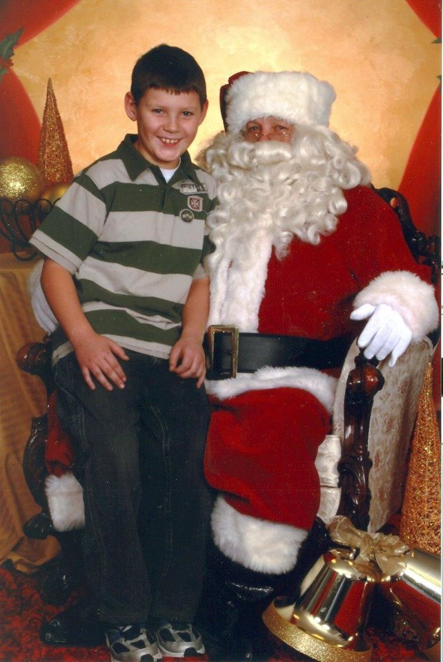 Austin T. Denney (9)and Santa at Farmers Insurance Call Center in Shepherd Mall.  He is as big as Santa this year, so he decided this would be his last year taking pictures.<br/><b>Community Photo By:</b> Santa's Helper<br/><b>Submitted By:</b> Kellie, Bethany