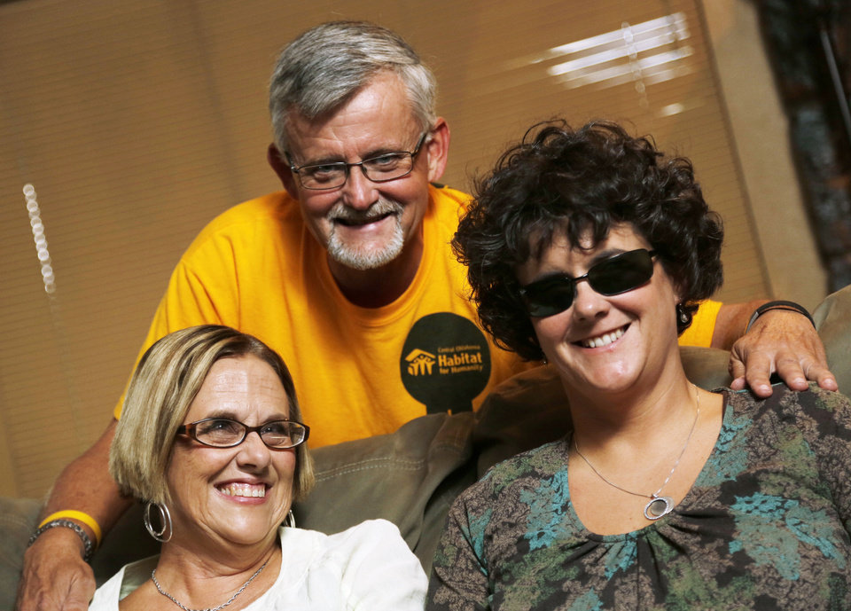 Photo - Gary Farnum and his wife Glenda, left, and daughter Audrey, right, at their home in Oklahoma City, October 1, 2012. Photo by Doug Hoke, The Oklahoman