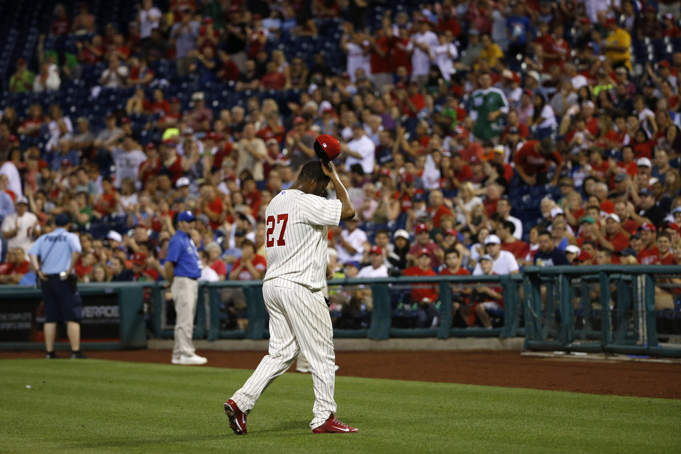 Photo - Philadelphia Phillies starting pitcher Roberto Hernandez walks to the dugout after being ejected for hitting Chicago Cubs' Starlin Castro with a pitch during the sixth inning of a baseball game, Friday, June 13, 2014, in Philadelphia. (AP Photo/Matt Slocum)