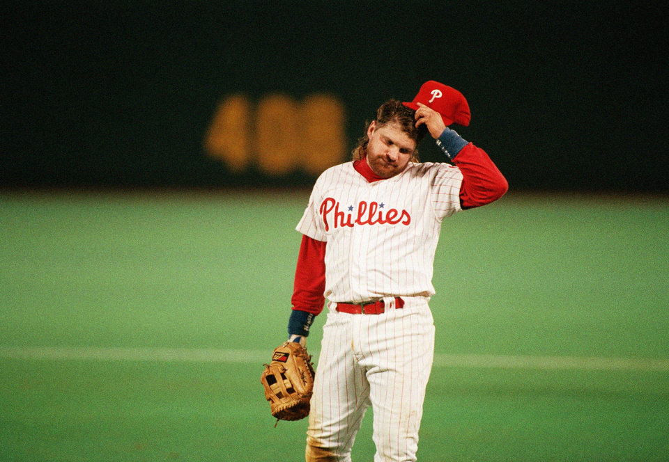 Photo - MAJOR LEAGUE BASEBALL / REACTION: The Philadelphia Phillies' John Kruk reacts after a missed double play in the ninth inning of Game 3 of the World Series with Toronto Blue Jays in Philadelphia, on Oct. 19, 1993. The Jays crushed the Phillies 10-3 to take a 2-1 lead in the best-of-seven-series. (AP Photo/Elise Amendola) ORG XMIT: APHS130003 ORG XMIT: 0805311935212896