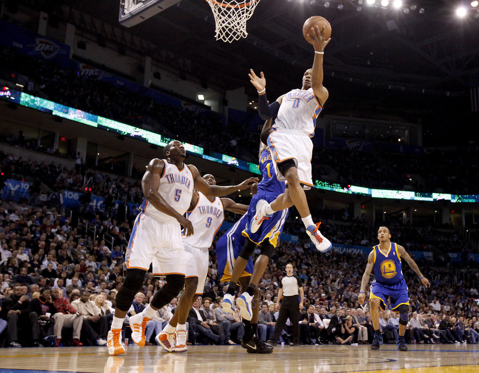 Photo - Oklahoma City's Russell Westbrook (0) goes to the basket during the NBA basketball game between the Oklahoma City Thunder and the Golden State Warriors at the Oklahoma City Arena, Tuesday, March 29, 2011. Photo by Bryan Terry, The Oklahoman