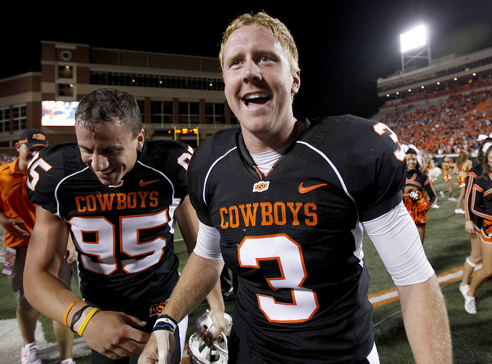 Photo - OSU's Brandon Weeden (3) celebrates with kicker Dan Bailey (95) following the college football game between Texas A&M University (TAMU) and Oklahoma State University (OSU) at Boone Pickens Stadium in Stillwater, Okla., Thursday, Sept. 30, 2010. Photo by Sarah Phipps, The Oklahoman