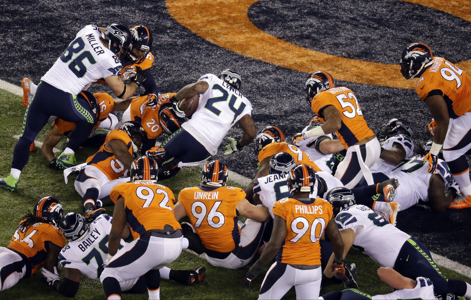 Photo - Seattle Seahawks' Marshawn Lynch (24) rushes for a touchdown during the first half of the NFL Super Bowl XLVIII football game against the Denver Broncos  Sunday, Feb. 2, 2014, in East Rutherford, N.J. (AP Photo/Mel Evans)