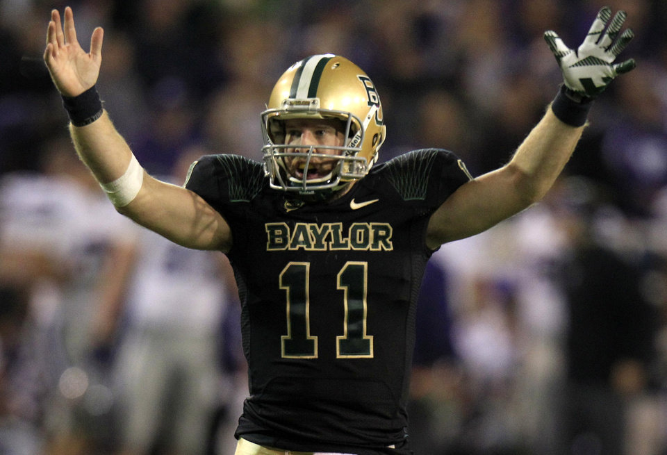 Baylor quarterback Nick Florence (11) celebrates a touchdown during the third quarter for the NCAA college football game against Kansas State, Saturday, Nov. 17, 2012, in Waco Texas. (AP Photo/LM Otero) ORG XMIT: TXMO220