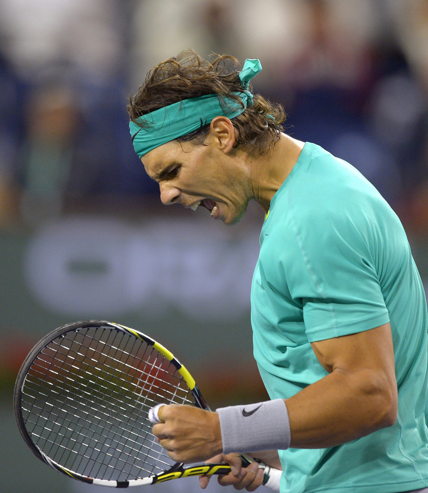 Rafael Nadal, of Spain, reacts after winning a point over Ryan Harrison, of the United State, at the BNP Paribas Open tennis tournament, Saturday, March 9, 2013, in Indian Wells, Calif. (AP Photo/Mark J. Terrill)