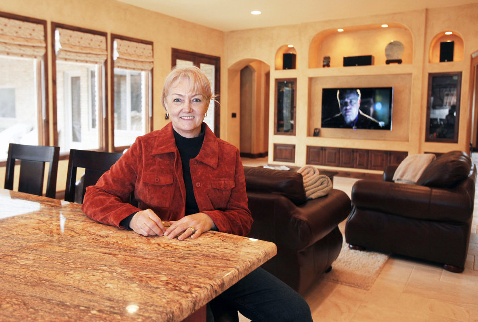 Homeowner Sharron Wolf shows the living room of her home, built with the aid of UBuildIt, at 3208 Edinburgh Drive in Edmond. PHOTO BY PAUL HELLSTERN, THE OKLAHOMAN