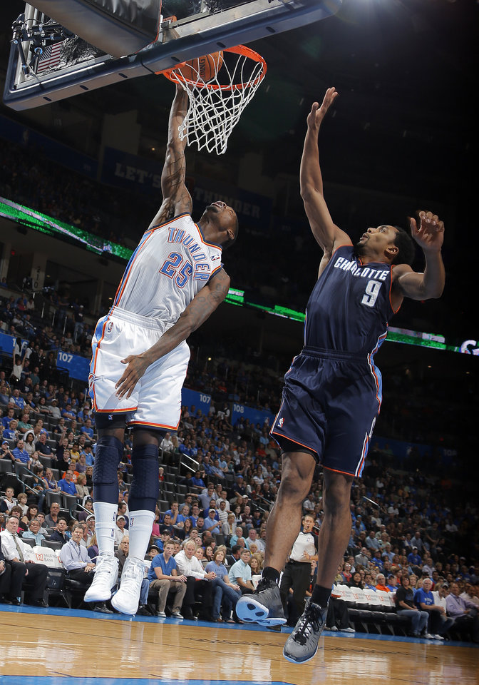 Oklahoma City\'s DeAndre Liggins (25) dunks in front of Charlotte\'s Gerald Henderson (9) during the preseason NBA game between the Oklahoma City Thunder and the Charlotte Bobcats at Chesapeake Energy Arena in Oklahoma City, Tuesday, Oct. 16, 2012. Photo by Sarah Phipps, The Oklahoman