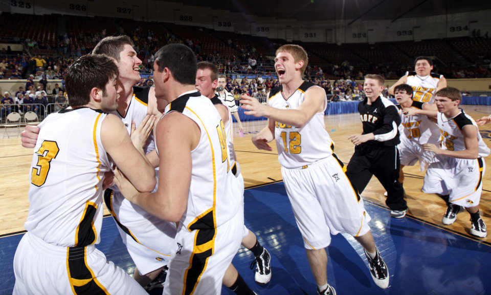Photo - Roff celebrates their win over Red Oak during the final of the Class B boys basketball state tournament at the State Fair Arena, Saturday, March 6, 2010, in Oklahoma City. Photo by Sarah Phipps, The Oklahoman