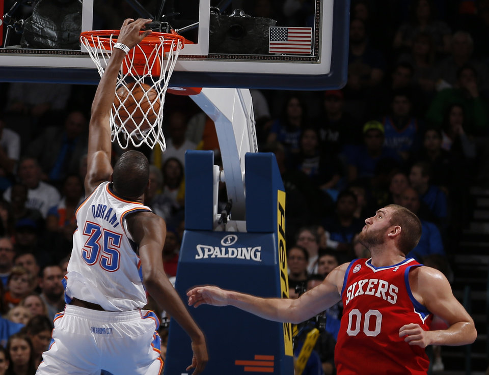 Oklahoma City\'s Kevin Durant (35) dunks in front of Philadelphia\'s Spencer Hawes (00) during the NBA game between the Oklahoma City Thunder and the Philadelphia 76ers at the Chesapeake Energy Arena in Oklahoma City, Friday,Jan. 4, 2013. Photo by Sarah Phipps, The Oklahoman
