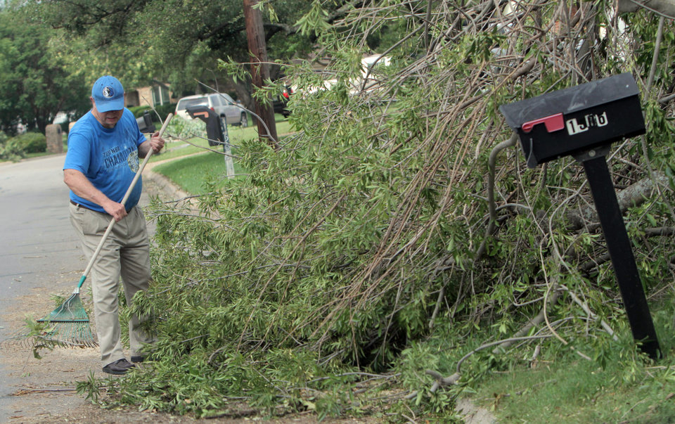 Photo - Don Graf cleans his property in Cleburne, Texas, Friday, May 17, 2013. On Wednesday, powerful storms produced 16 tornadoes in the area. (AP Photo/Mike Fuentes)