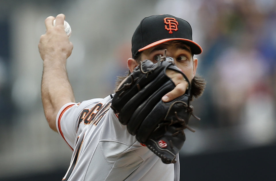 Photo - San Francisco Giants starting pitcher Madison Bumgarner winds up in the first inning of a baseball game against the New York Mets in New York, Sunday, Aug. 3, 2014. (AP Photo/Kathy Willens)