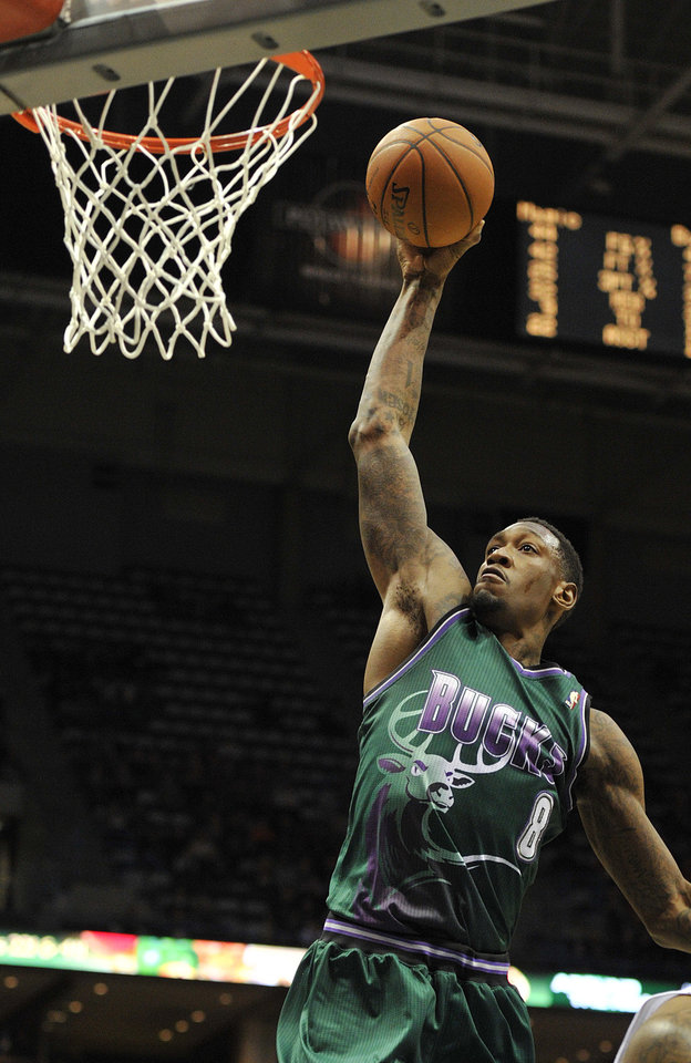 Photo - Milwaukee Bucks' Larry Sanders (8) dunks the ball against the Orlando Magic during the second half of an NBA basketball game on Saturday, Feb. 2, 2013, in Milwaukee. The Bucks defeated the Magic 107-98. (AP Photo/Jim Prisching)
