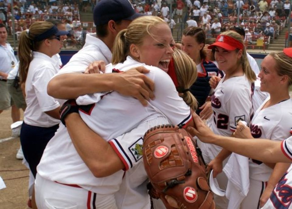 Photo -  Arizona pitcher Jennie Finch gets a hug from a teammate after winning the 2001 WCWS title. [OKLAHOMAN ARCHIVES]