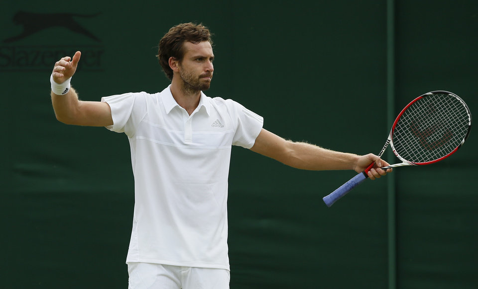 Photo - Ernests Gulbis of Latvia gestures during his first round match against Jurgen Zopp of Estonia at the All England Lawn Tennis Championships in Wimbledon, London,  Monday, June  23, 2014. (AP Photo/Alastair Grant)