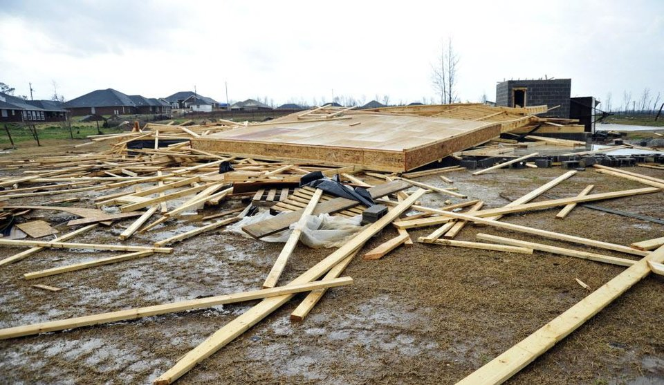 Photo -   A home under construction after being leveled during an April 2011 tornado, lies damaged again, Friday, March 2, 2012 in Harvest, Ala., after another reported tornado. (AP Photo/The Huntsville Times, Bob Gathany)