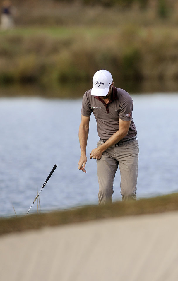 Photo - Chris Kirk throws his wedge after hitting out of the rough on the 15th hole during the final round of the McGladrey Classic golf tournament on Sunday, Nov. 10, 2013, in St. Simons Island, Ga. (AP Photo/Stephen Morton)