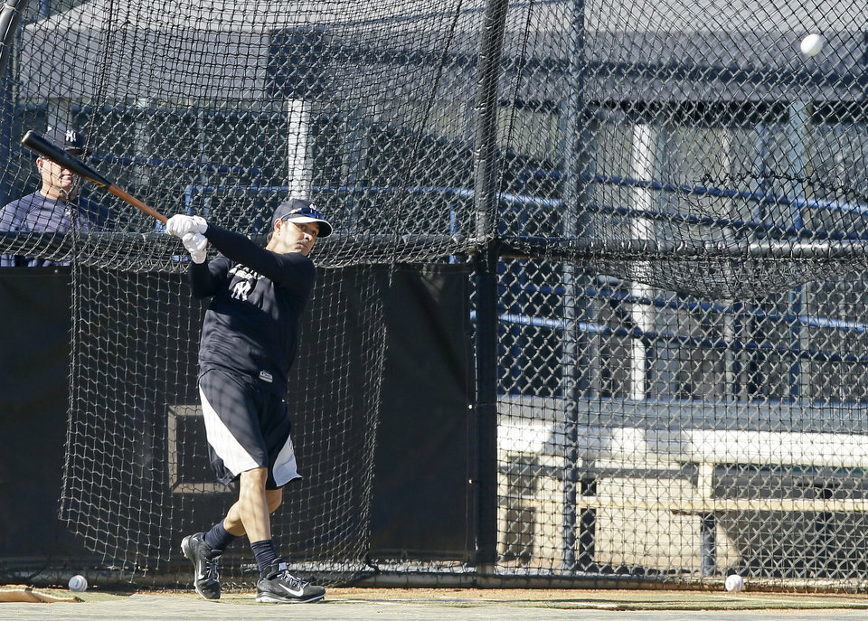 Photo - New York Yankees infielder Brian Roberts hits in the batting cage during spring training baseball practice, Monday, Feb. 17, 2014, in Tampa, Fla. (AP Photo/Charlie Neibergall)