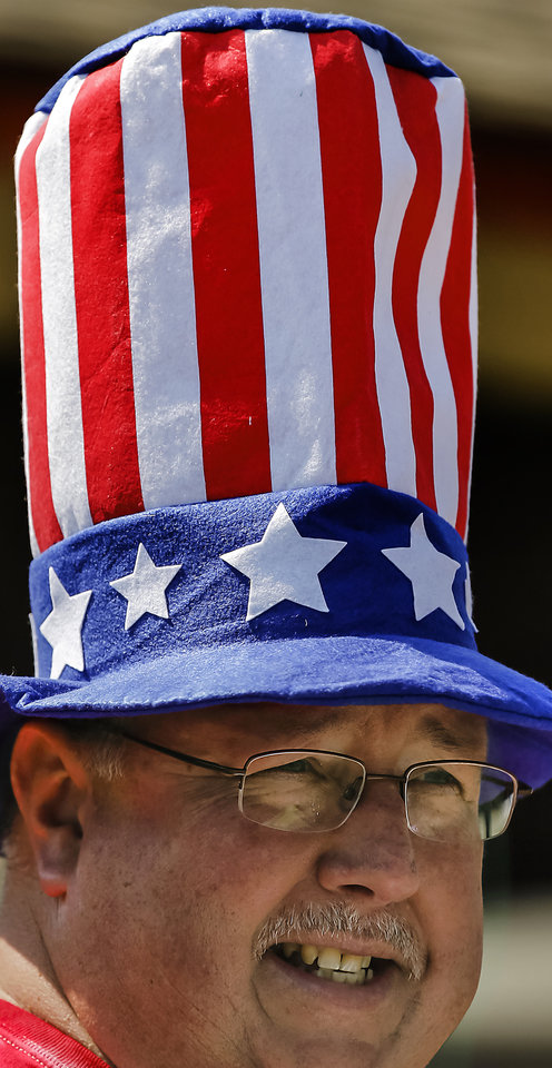 Chairman of the Yukon Park board, Joe Edwards wears his holiday hat while judging the children's parade during the Yukon Freedom Fest at the Yukon City Park on Thursday , July 4, 2013, in Yukon, Okla. Photo by Chris Landsberger, The Oklahoman