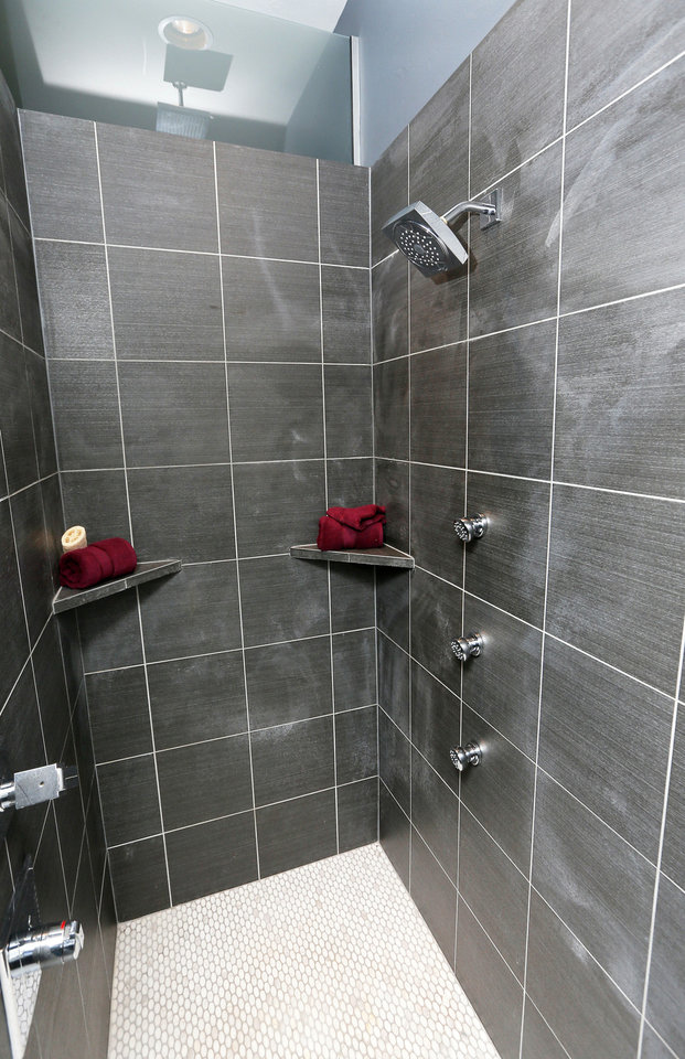 The shower in the master bathroom at 17320 White Hawk Drive features multiple showerheads.