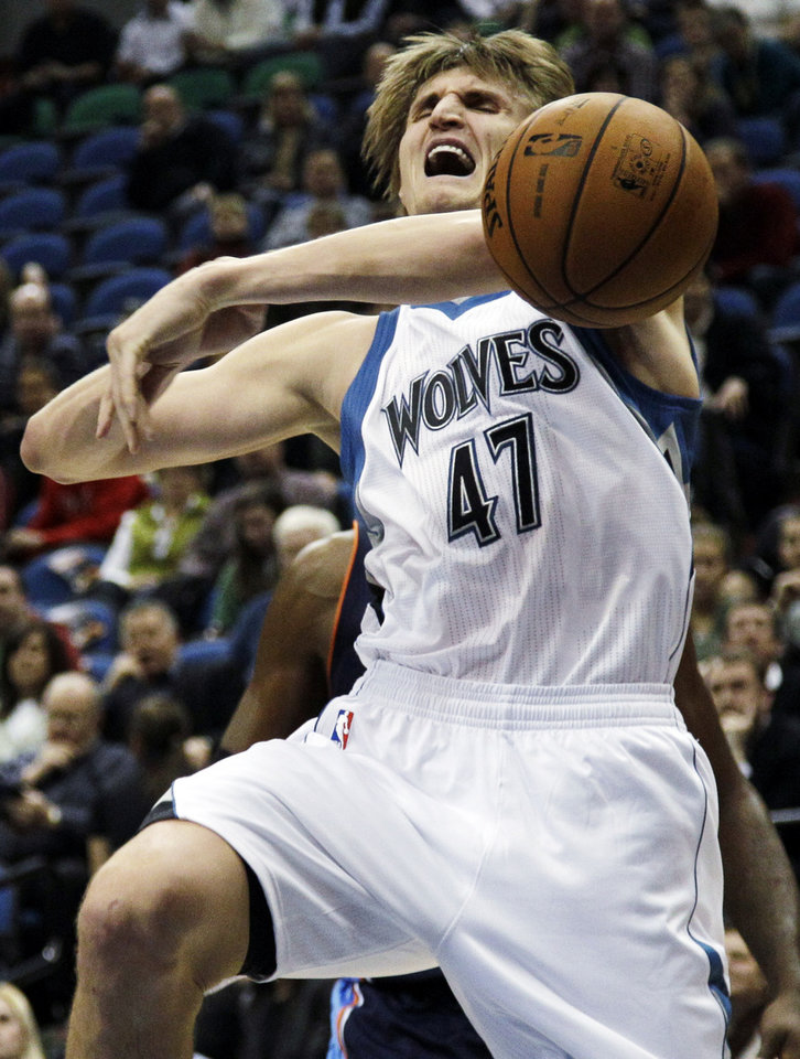 Minnesota Timberwolves\' Andrei Kirilenko (47), of Russia, reacts as he is fouled by Charlotte Bobcats\' Michael Kidd-Gilchrist, rear, in the first half of an NBA basketball game, Wednesday, Nov. 14, 2012, in Minneapolis. (AP Photo/Jim Mone)