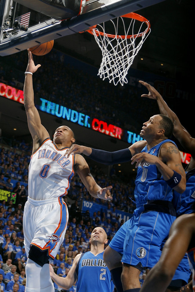 Oklahoma City\'s Russell Westbrook (0) shoots as Dallas\' Shawn Marion (0) defends during game one of the first round in the NBA playoffs between the Oklahoma City Thunder and the Dallas Mavericks at Chesapeake Energy Arena in Oklahoma City, Saturday, April 28, 2012. Photo by Sarah Phipps, The Oklahoman