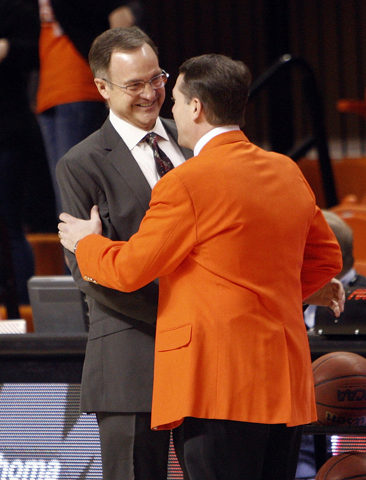 Photo - OU head coach Lon Kruger, left, and OSU head coach Travis Ford talk before the Bedlam men's college basketball game between the Oklahoma State University Cowboys and the University of Oklahoma Sooners at Gallagher-Iba Arena in Stillwater, Okla., Monday, Jan. 9, 2012. Photo by Nate Billings, The Oklahoman
