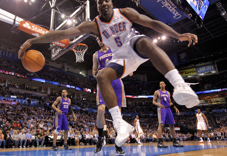 Photo - Oklahoma City Thunder center Kendrick Perkins (5) saves a loose ball during the NBA basketball game between the Oklahoma City Thunder and the Phoenix Suns at the Chesapeake Energy Arena on Wednesday, March 7, 2012 in Oklahoma City, Okla.  Photo by Chris Landsberger, The Oklahoman