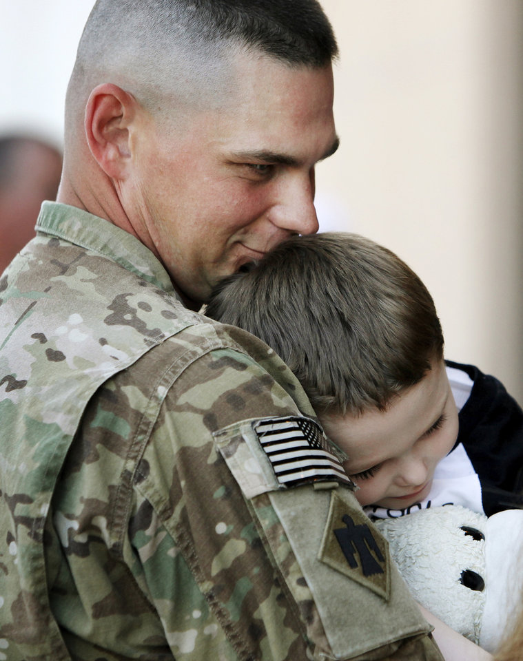 1st Lt. Joshua Starks holds his 4-year-old son, Seraphin Starks, after a homecoming ceremony for members of the Oklahoma National Guard's 45th Infantry Brigade Combat Team returning from Afghanistan at the Will Rogers Air National Guard Base in Oklahoma City, Friday, March 30, 2012. Photo by Nate Billings, The Oklahoman