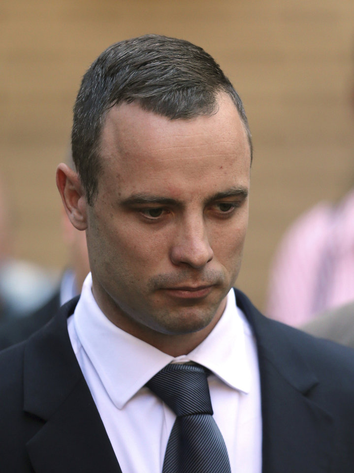Photo - Oscar Pistorius leaves the high court in Pretoria, South Africa, Wednesday, May 14, 2014. The judge overseeing the murder trial of Pistorius on Wednesday ordered the double-amputee athlete to undergo psychiatric tests, meaning that the trial proceedings will be delayed. (AP Photo/Themba Hadebe)