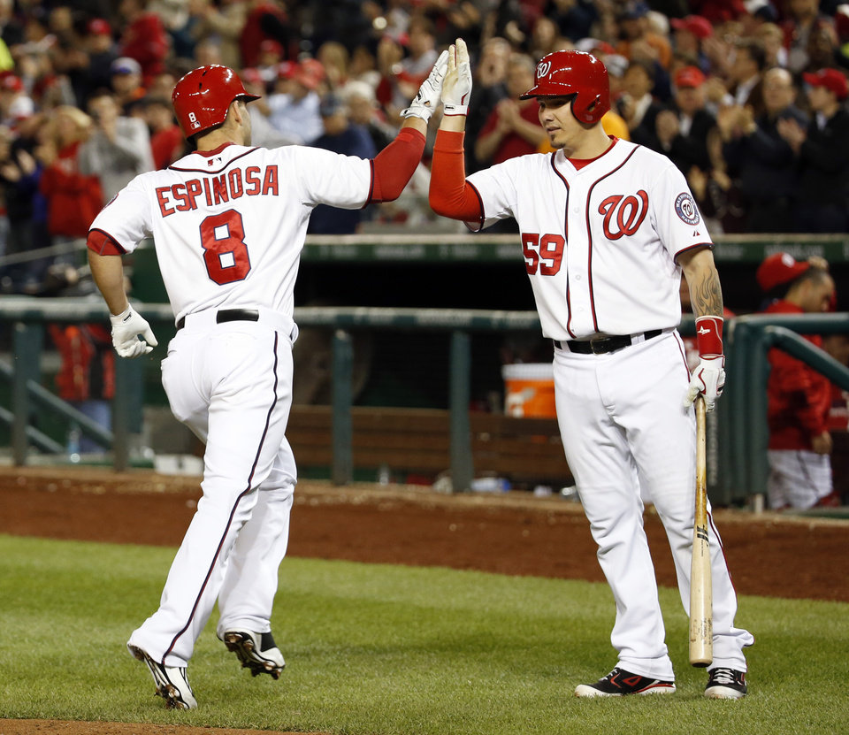 Photo - Washington Nationals' Danny Espinosa (8) celebrates his solo home run with Jose Lobaton during the sixth inning of a baseball game against the San Diego Padres at Nationals Park, Thursday, April 24, 2014, in Washington. (AP Photo/Alex Brandon)