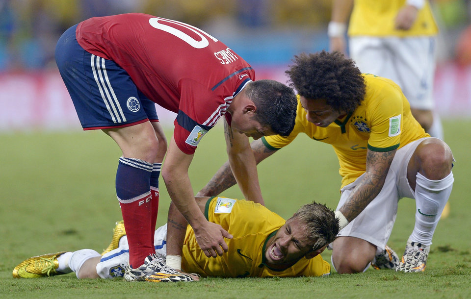 Photo - 10ThingstoSeeSports - Brazil's Neymar screams out after being fouled during the World Cup quarterfinal soccer match between Brazil and Colombia at the Arena Castelao in Fortaleza, Brazil, Friday, July 4, 2014. (AP Photo/Manu Fernandez, File)