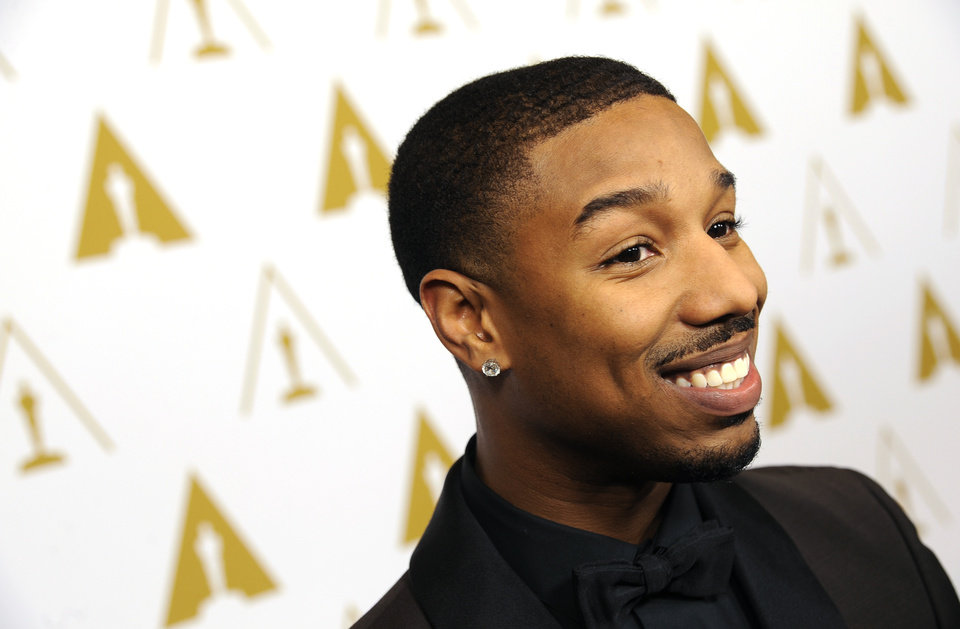 Photo - Actor and evening co-host Michael B. Jordan poses at the Academy of Motion Picture Arts and Sciences' annual Scientific and Technical Awards on Saturday, Feb. 15, 2014, in Beverly Hills, Calif. (Photo by Chris Pizzello/Invision/AP)