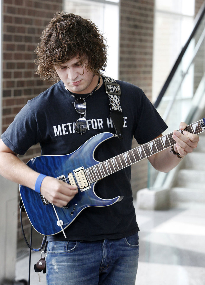 Photo - ACM@UCO student guitarist Dwight Hamlin playing  during an announcement Monday, May 14, 2012, that Van Halen will perform Sept. 15 at Chesapeake Energy Arena.  Photo by Paul B. Southerland, The Oklahoman