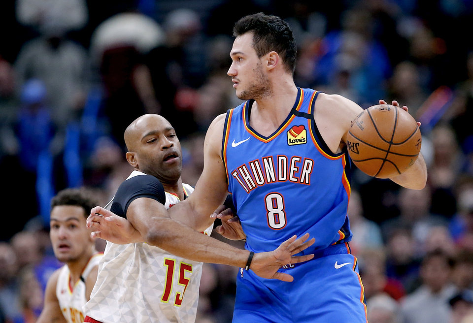 Photo - Oklahoma City's Danilo Gallinari (8) tries to get around Atlanta's Vince Carter (15) during the NBA basketball game between the Oklahoma City Thunder and the Atlanta Hawks at the Chesapeake Energy Arena in Oklahoma City,Friday, Jan. 24, 2020.  [Sarah Phipps/The Oklahoman]