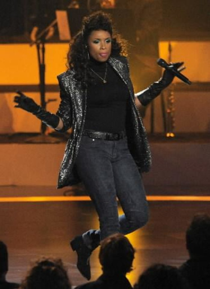"""Photo -  Singer Jennifer Hudson performs onstage at """"We Will Always Love You: A Grammy Salute to Whitney Houston,"""" at Nokia Theatre on Thursday, Oct. 11, 2012, in Los Angeles. The one-hour concert tribute will air on CBS on Nov. 16. (Photo by Chris Pizzello/Invision/AP)"""