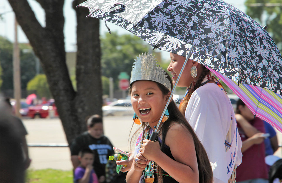 Lil Miss Oklahoma Indian Nation Tina Mae Ortiz uses an umbrella to keep the sun off while riding in the Red Earth parade, Friday, June 7, 2013. Photo by David McDaniel, The Oklahoman