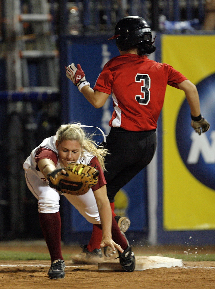 Photo - Alabama's Dani Woods (23) keeps her feet on the bag to get out Brooke Brodhead (3) of Louisiana-Lafayette in the fifth inning during the softball game in the Women's College World Series between Louisiana-Lafayette and Alabama at ASA Hall of Fame Stadium in Oklahoma City, Saturday, May 31, 2008. BY NATE BILLINGS, THE OKLAHOMAN