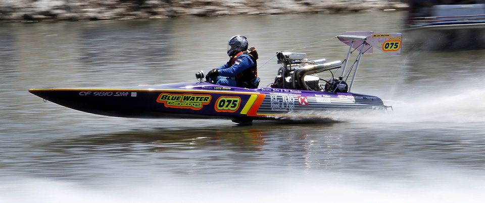 Larry Skero takes a test run during the Oklahoma City Nationals professional drag boat racing on the Oklahoma River in Oklahoma City, Thursday, June 8, 2012. Photo By Steve Gooch, The Oklahoman