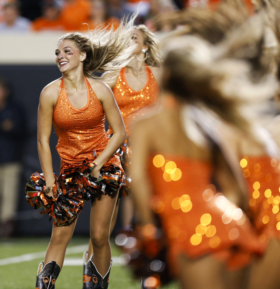 Photo - The OSU pom squad performs during a college football game between Oklahoma State (OSU) and South Alabama at Boone Pickens Stadium in Stillwater, Okla., Saturday, Sept. 8, 2018. Photo by Nate Billings, The Oklahoman