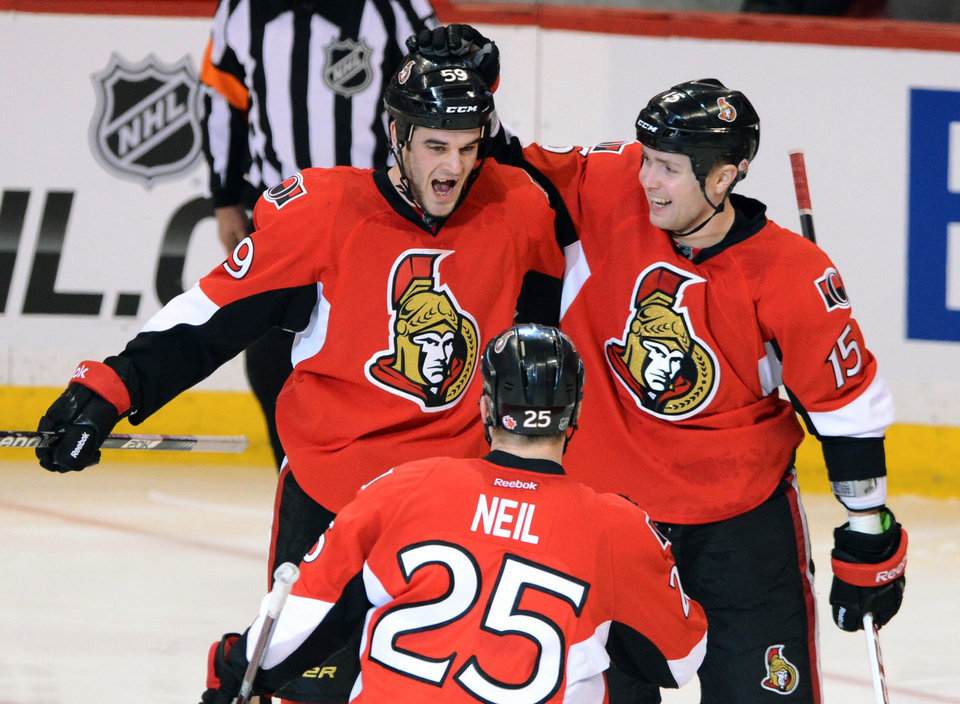 Photo - Ottawa Senators' Dave Dziurzynski celebrates his second-period goal with Chris Neil (25) and Zack Smith (15) during their NHL hockey game against the Montreal Canadiens, Monday, Feb. 25, 2013, in Ottawa, Ontario. (AP Photo/The Canadian Press, Sean Kilpatrick)