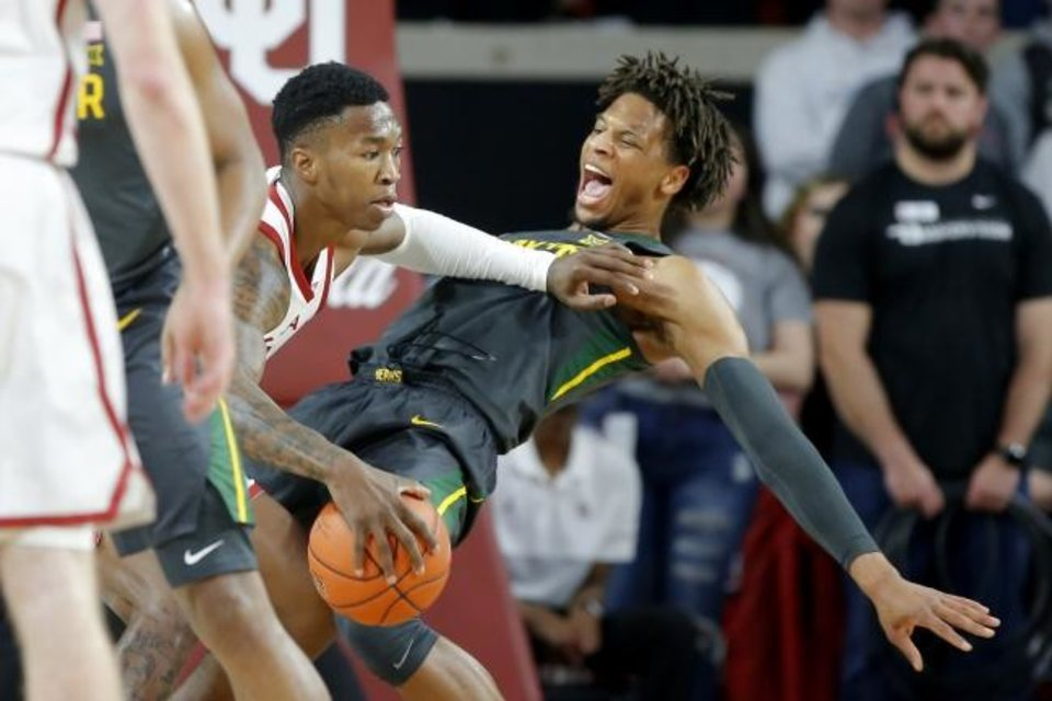 Photo -  Oklahoma's Kristian Doolittle (21) tries to get past Baylor's Freddie Gillespie (33) during a men's NCAA basketball game between the University of Oklahoma Sooners (OU) and the Baylor Bears at the Lloyd Noble Center in Norman, Okla., Tuesday, Feb. 18, 2020. [Bryan Terry/The Oklahoman]