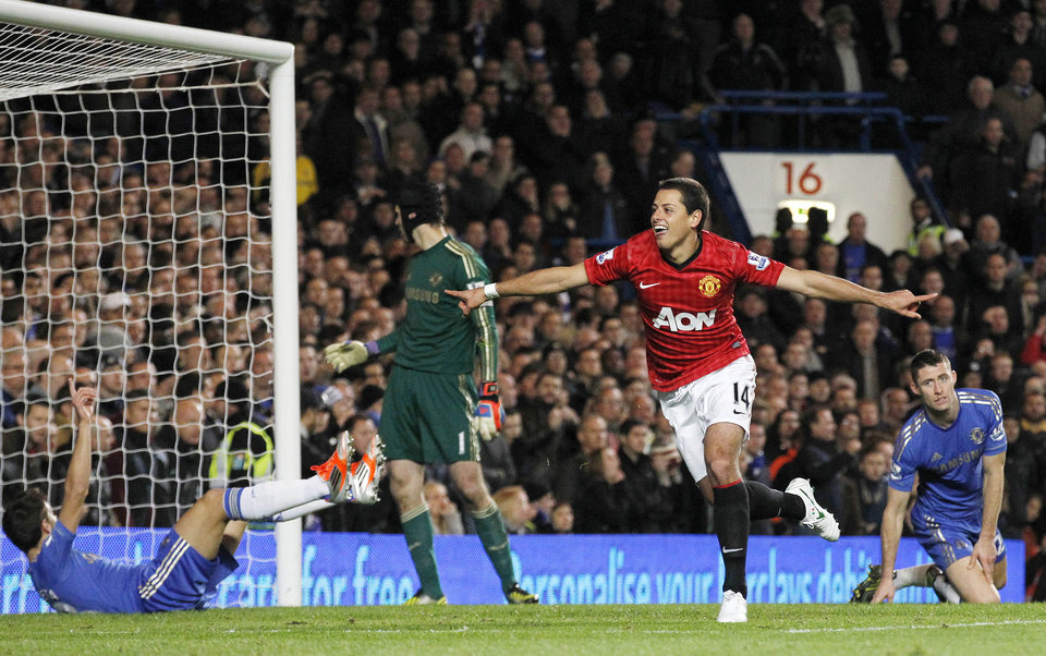 Manchester United's Javier Hernandez, center, celebrates his goal against Chelsea during their English Premier League soccer match at Stamford Bridge, London, Sunday, Oct. 28, 2012. (AP Photo/Sang Tan)